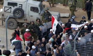 Shooting at Syrian protesters may violate int'l law' By RON FRIEDMAN
