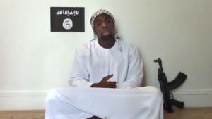 Amedy Coulibaly aves le drapeau de Daesh Etat islamique