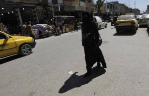 677179-a-woman-wearing-a-full-veil-niqab-walks-along-a-street-in-the-northern-province-of-raqqa_172713_large