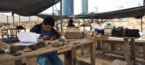a-worker-for-the-israel-antiquities-authority-cleans-findings-at-an-archaeological-dig-in-a-future-construction-site-in-tel-aviv-where-fragments-of-ancie