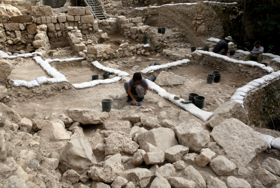 "Workers from the Israeli Antiquity Authorities dig on November 3, 2015 at the excavation site near the City of David adjacent to Jerusalem's Old City walls where researchers believe to have found the remains of the stronghold the Acra, from which the Greek King Antiochus IV was able to control Jerusalem and monitor activity at the holy site known to Jews as the Temple Mount. Israel's antiquities body claimed to have solved ""one of Jerusalem's greatest archeological mysteries"" by unearthing from under a car park the 2,000-year-old citadel, which archaeologists have puzzled for more than a century over its location. AFP PHOTO / GALI TIBBON"
