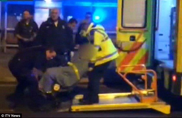 2F1F47D200000578-0-Emergency_Paramedics_help_the_victim_into_an_ambulance_outside_t-a-9_1449441879016