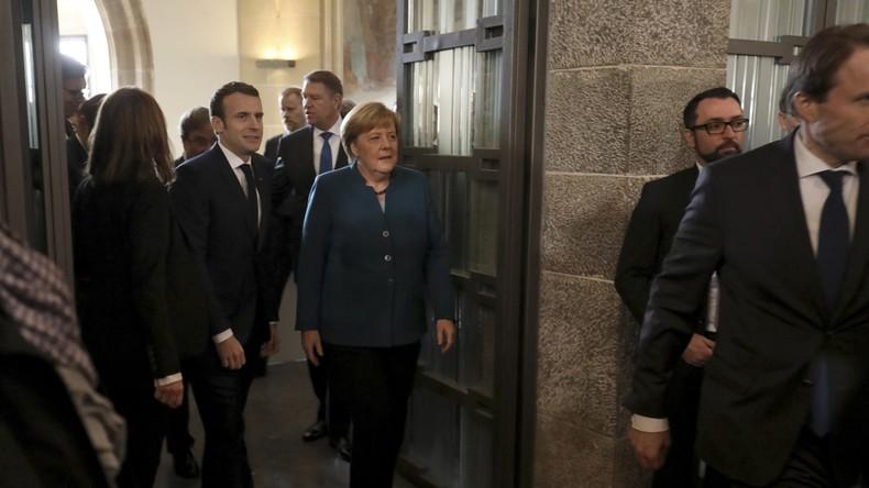 «Macron démission», «Merkel doit partir» : huées pour les deux dirigeants à Aix-la-Chapelle (VIDEO)