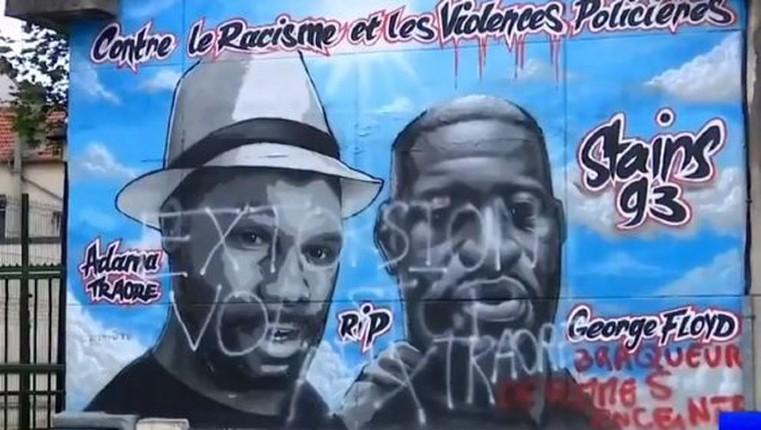 """Violences policières: : la fresque """"Adama Traoré"""" taguée « Extorsion, vol, stop aux Traoré. Braqueur de femmes enceintes »"""
