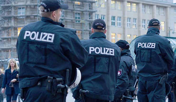 300 GERMAN OFFICERS RAID 'ISLAMIST HOTSPOT'